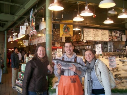 With one of the fish throwers at Pike Place.